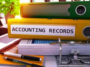Accounting Records - Yellow Ring Binder on Office Desktop with Office Supplies and Modern Laptop. Accounting Records Business Concept on Blurred Background. 3D Render.