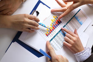 Financial paper charts and graphs on the tableConstruction Bookkeepers: Tips for Producing Quality Financial Statements