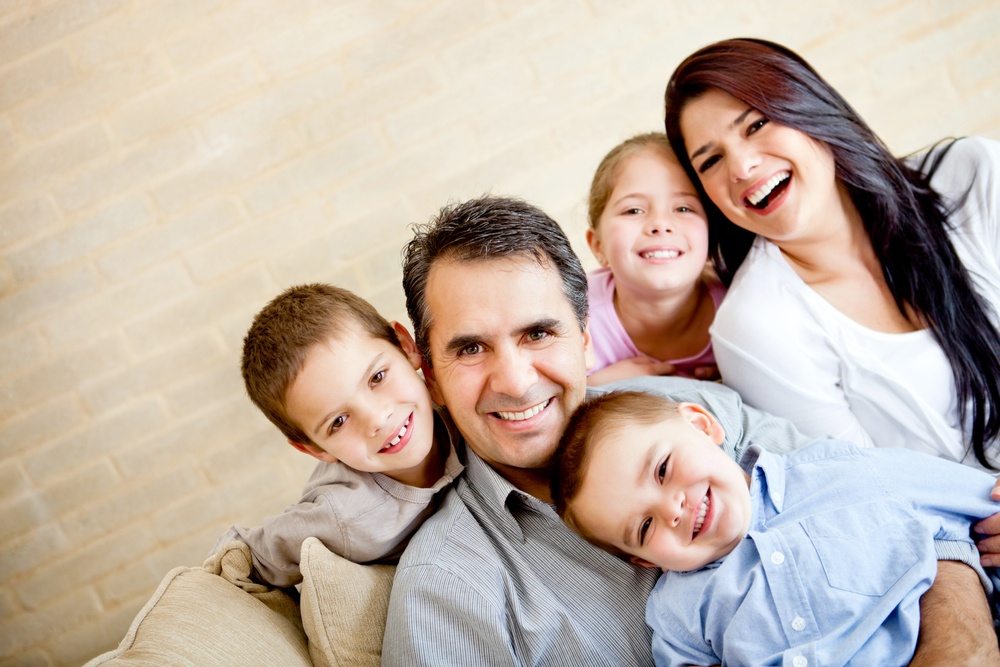 Portrait of a happy family smiling at home