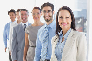 Smiling employees in a line at workTax-Favored Fringe Benefits for Employees: What Businesses can Offer