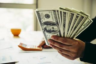 money -  hand holding money.jpg