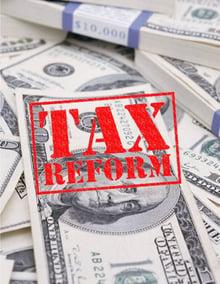 tax reform stamp on money.jpg